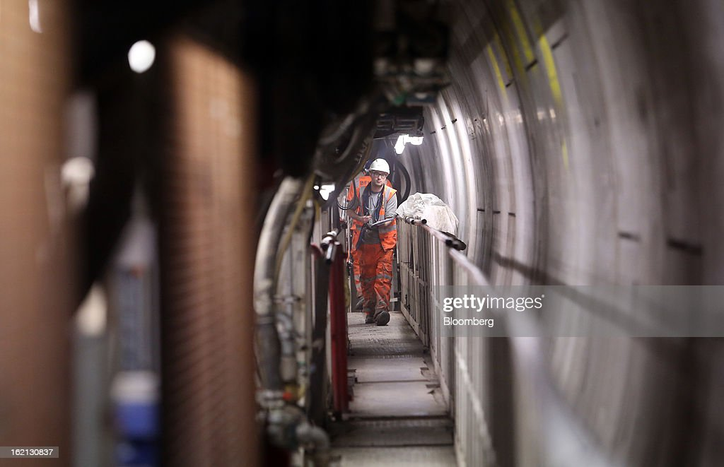 An employee passes along a walkway inside a tunnel-boring machine in one of the western tunnels, developed by Crossrail, beneath London, U.K., on Tuesday, Feb. 19, 2013. Network Rail Ltd. projects include a 6 billion-pound upgrade to the Thameslink line that spans London from north to south and the Crossrail project to build an east-west line through the capital, Finance Director Patrick Butcher said. Photographer: Chris Ratcliffe/Bloomberg via Getty Images