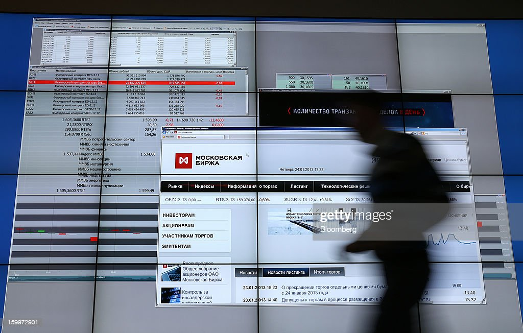 An employee passes an electronic information screen in the reception area of the Moscow Exchange in Moscow, Russia, on Thursday, Jan. 24, 2013. The Moscow Exchange, Russia's biggest bourse, plans to raise more than $500 million in an initial public offering, according to a person with knowledge of the matter. Photographer: Andrey Rudakov/Bloomberg via Getty Images