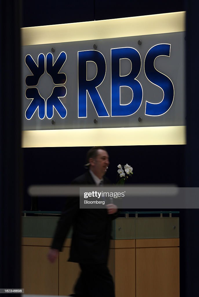 An employee passes through the reception area of an office of Royal Bank of Scotland Group Plc (RBS), in London, U.K., on Friday, Feb. 22, 2013. RBS, Britain's biggest publicly owned lender, was fined $612 million by regulators in the U.K. and the U.S. for rigging the London interbank offered rate and similar benchmarks. Photographer: Chris Ratcliffe/Bloomberg via Getty Images