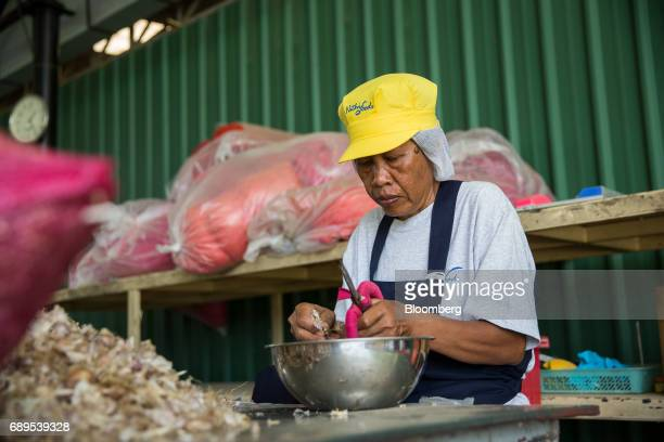 An employee peels garlic cloves at a Nithi Foods Co factory in the San Pa Tong district of Chiang Mai Thailand on Tuesday May 23 2017 Thailand's...