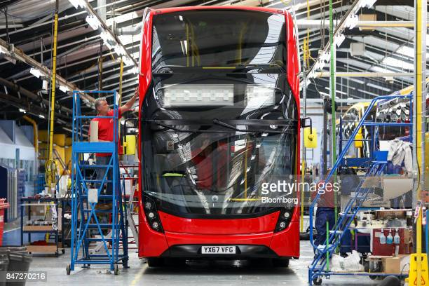 An employee performs a final quality inspection on an Enviro 400 London bus at the Alexander Dennis Ltd factory in Scarborough UK on Wednesday Sept...