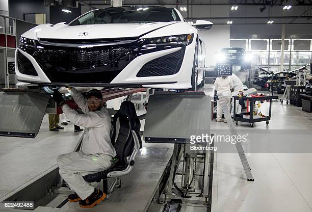An employee performs diagnostic inspection on a new Honda Motor Co 2017 Acura NSX vehicle at the Honda Performance Manufacturing Center in Marysville...