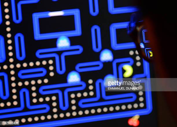 An employee plays the video game PacMan during an exhibition preview featuring 14 video games acquired by The Museum of Modern Art in New York March...