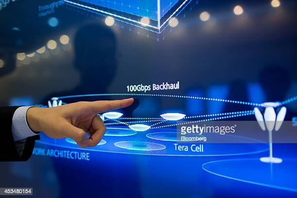 An employee points to an illustration of the architecture of a network during a tour at the Huawei Technologies Co campus in the Longgang district of...