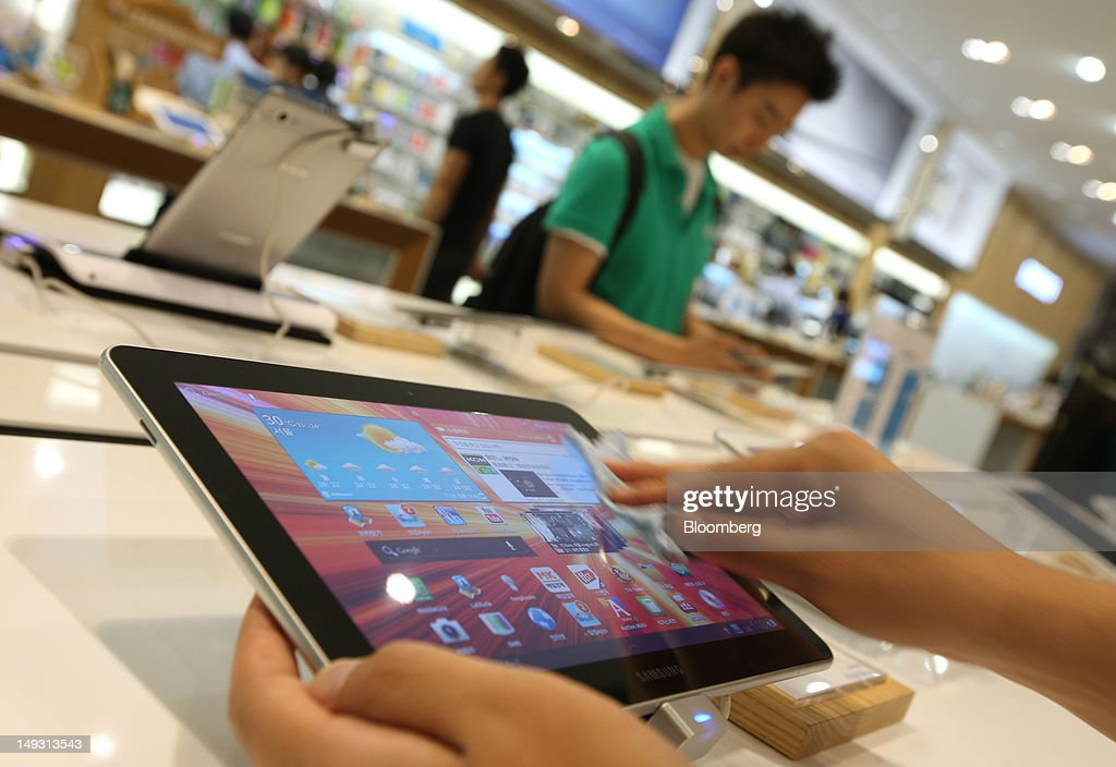 An employee polishes a Samsung Electronics Co. Galaxy Tab 10.1 tablet computer at the company's flagship store in Seoul, South Korea, on Thursday, July 26, 2012. Samsung, the world's largest maker of TVs and mobile phones, reported second-quarter profit that missed analysts' estimates after chip prices weakened and smartphone output failed to keep up with demand. Photographer: SeongJoon Cho/Bloomberg via Getty Images