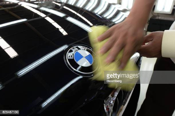 An employee polishes the hood of a BMW 530i sedan on the production line at a PT Gaya Motor plant in Jakarta Indonesia on Wednesday Aug 2 2017 BMW is...