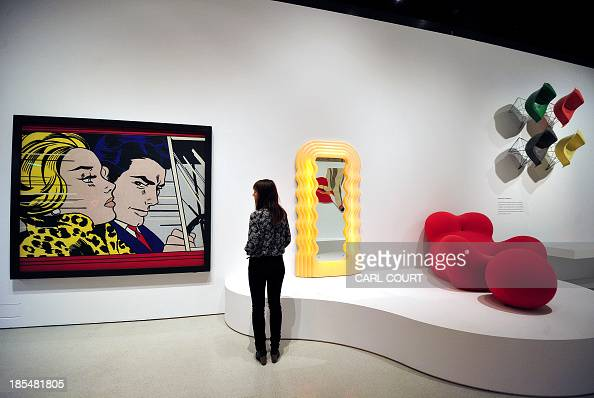 an employee poses next to 39 in the car 39 l artwork by roy lichtenstein dispalyed at the pop art. Black Bedroom Furniture Sets. Home Design Ideas