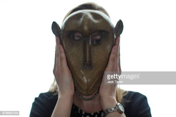 An employee poses with a 19th century African monkey mask at 5 Cromwell Place on May 4 2017 in London England British art dealer Oliver Hoare...