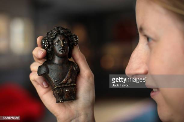 An employee poses with a 1st century BC Bust of Bacchus from Imperial Rome at 5 Cromwell Place on May 4 2017 in London England British art dealer...