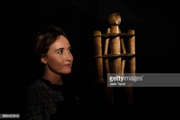 An employee poses with 'Homme ' by Alberto Giacometti at Christie's London on September 29 2017 in London England Christie's Auction House is to sell...