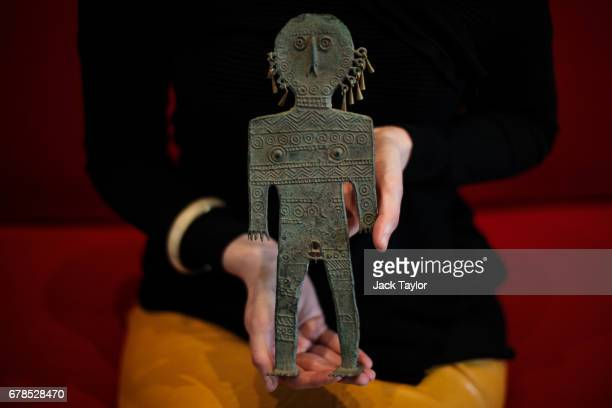 An employee poses with The Tattooed Man Southern Siberia 5th3rd Century BC at 5 Cromwell Place on May 4 2017 in London England British art dealer...