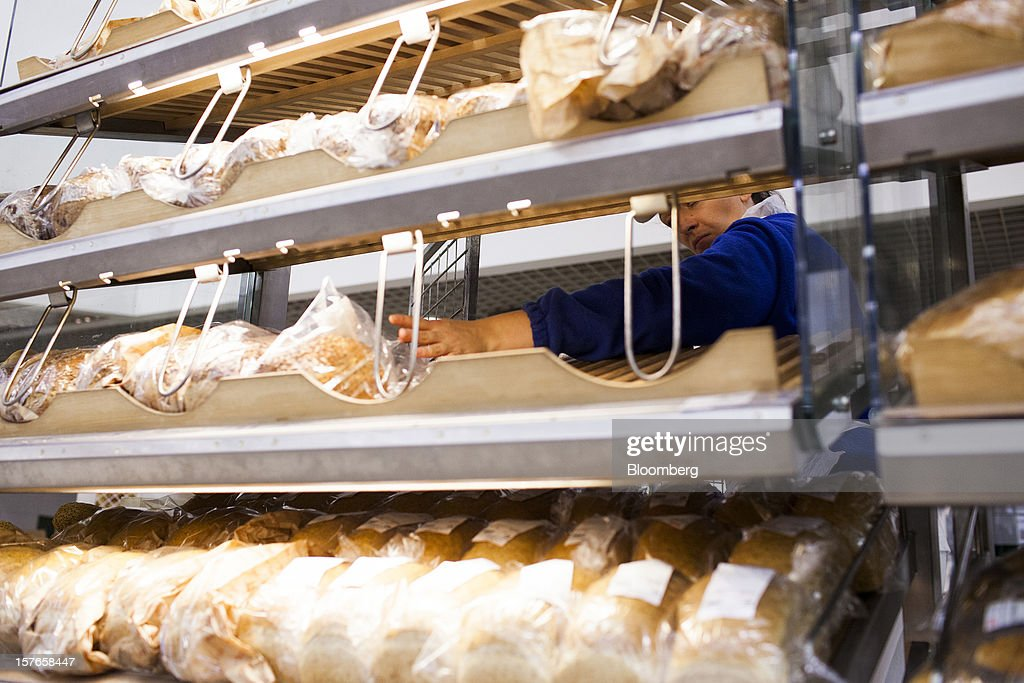 An employee prepares a display of freshly baked bread in the bakery section of a Real supermarket in Wroclaw, Poland, on Wednesday, Dec. 5, 2012. Metro AG, Germany's biggest retailer, agreed to sell its Real grocery stores in eastern Europe to Groupe Auchan SA of France for 1.1 billion euros ($1.4 billion) in Chief Executive Officer Olaf Koch's first big deal since taking the helm. Photographer: Bartek Sadowski/Bloomberg via Getty Images