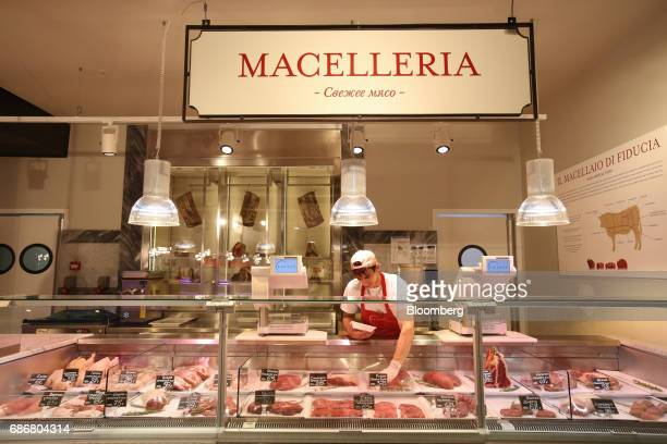 An employee prepares a display of Italian meats inside the new Eataly food store operated by Eataly Net Srl at the Kievsky shopping mall in Moscow...