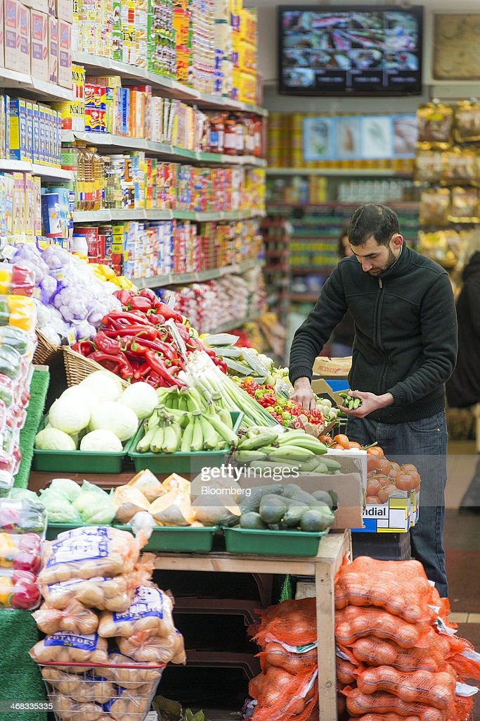 An employee prepares a display of vegetables at a food store in Croydon, south London, U.K., on Monday, Feb. 10, 2014. Westfield Group, Australia's biggest mall operator, and Hammerson Plc won preliminary approval to rebuild the Whitgift Centre mall in south London as part of a project valued at about 1 billion pounds ($1.6 billion). Photographer: Jason Alden/Bloomberg via Getty Images