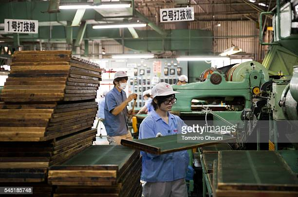 An employee prepares a rack for mosquito coils at the Kishu Factory of Dainihon Jochugiku Co Ltd on July 6 2016 in Arita Japan Japanese insect...