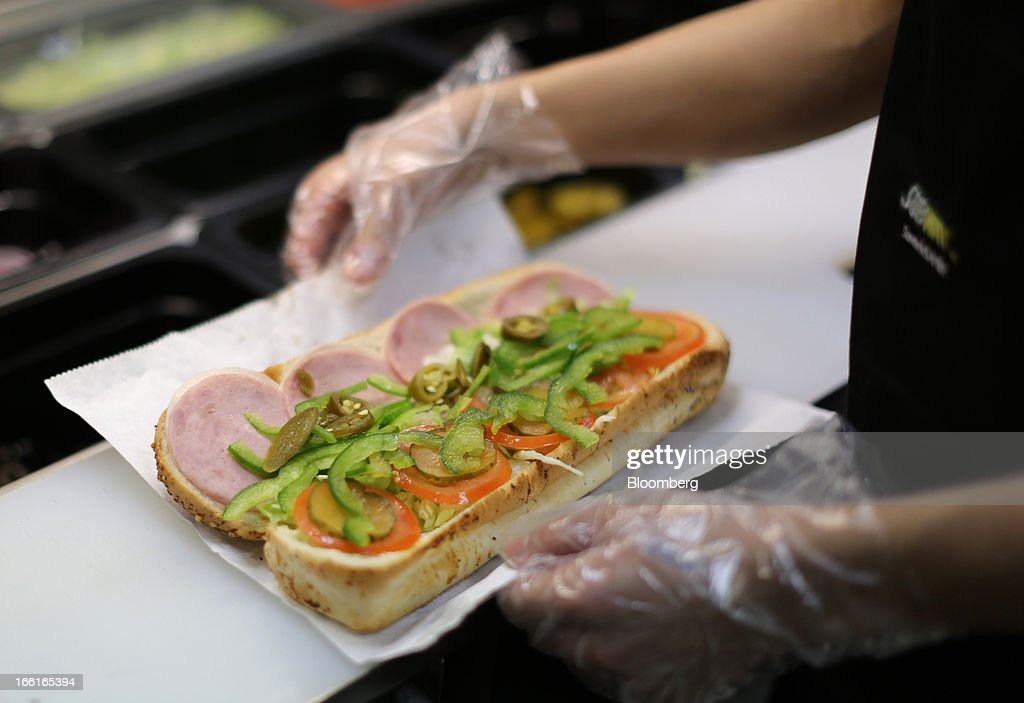 An employee prepares a sandwich inside a Subway fast food restaurant in Moscow, Russia, on Sunday, April 7, 2013. McDonald's, which virtually created the market for burgers and fries in the country and convinced Russians it's OK to eat with their hands, must fend off a growing challenge from rivals Burger King Worldwide Inc., Subway Restaurants, Yum! Brands Inc. and Wendy's Co. Photographer: Andrey Rudakov/Bloomberg via Getty Images