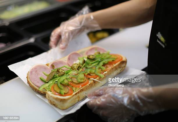 An employee prepares a sandwich inside a Subway fast food restaurant in Moscow Russia on Sunday April 7 2013 McDonald's which virtually created the...