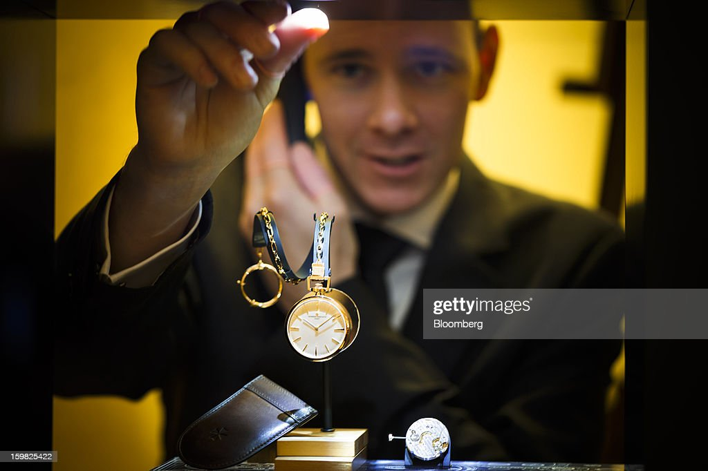 An employee prepares a watch display at the Vacheron Constantin, a unit of Cie. Financiere Richemont SA, booth during the first day of the Salon International de la Haute Horlogerie (SIHH) watch fair in Geneva, Switzerland, on Monday, Jan. 21, 2013. The Swiss watch industry slowed in the second half of 2012 as sales of timepieces and jewelry in Hong Kong, the biggest market for Swiss watchmakers, declined in August and October. Photographer: Valentin Flauraud/Bloomberg via Getty Images