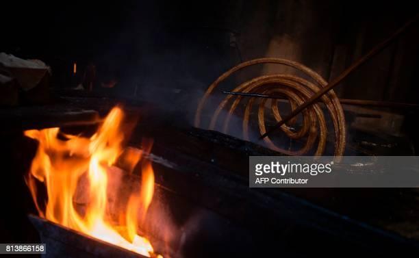 An employee prepares 'churros' at the traditional churreria 'La Manueta' on July 13 in Pamplona northern Spain 'La Manueta' a 138 yearold churreria...