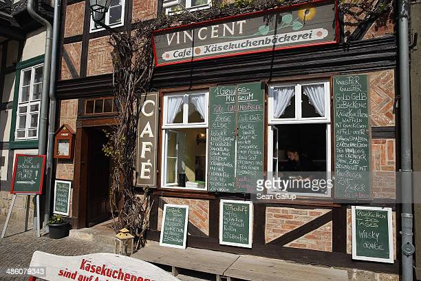 An employee prepares food at Vincent Cafe which specializes in cheesecake on April 20 2014 in Quedlinburg Germany Quedlinburg located in the Harz...