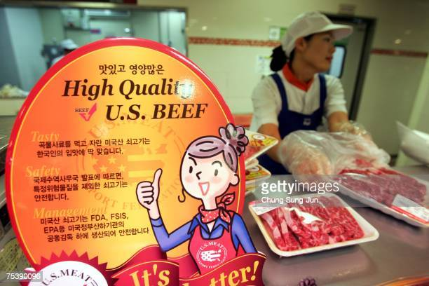 An employee prepares imported US beef at a store on July 13 2007 in Seoul South Korea South Korean outlets will put US beef on its shelves for the...