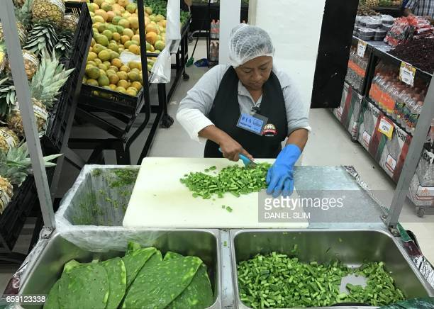 An employee prepares nopales at a supermarket in Cancun Quintana Roo Mexico on March 28 2017 Cancun is the most recognized Mexican tourist center in...