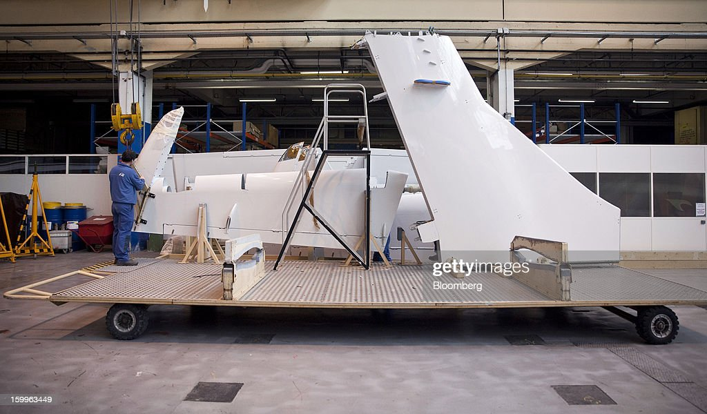 An employee prepares tailfin components during the construction of an ATR-72 turboprop aircraft, manufactured by Avions de Transport Regional (ATR), at the company's production facility in Colomiers, France, on Wednesday, Jan. 23, 2013. ATR, the world's largest maker of turbo-propeller airliners, reported record profit for 2012, even as it fell short of its shipment target amid production delays. Photographer: Balint Porneczi/Bloomberg via Getty Images