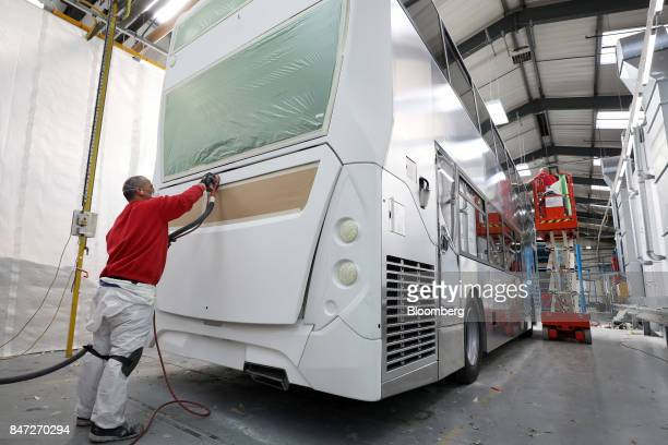 An employee prepares the rear of an Enviro 400 London for painting at the Alexander Dennis Ltd factory in Scarborough UK on Wednesday Sept 13 2017...