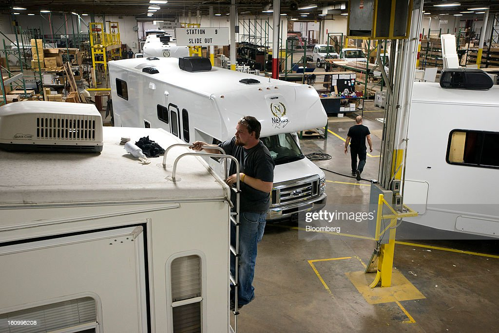 An employee prepares to clean off the top of a motorhome at Nexus RV in Elkhart, Indiana, U.S., on Friday, Feb. 8, 2013. Orders placed with U.S. factories increased less than forecast in December, reflecting a drop in non-durable goods that partly countered gains in construction equipment and computers. Photographer: Ty Wright/Bloomberg via Getty Images