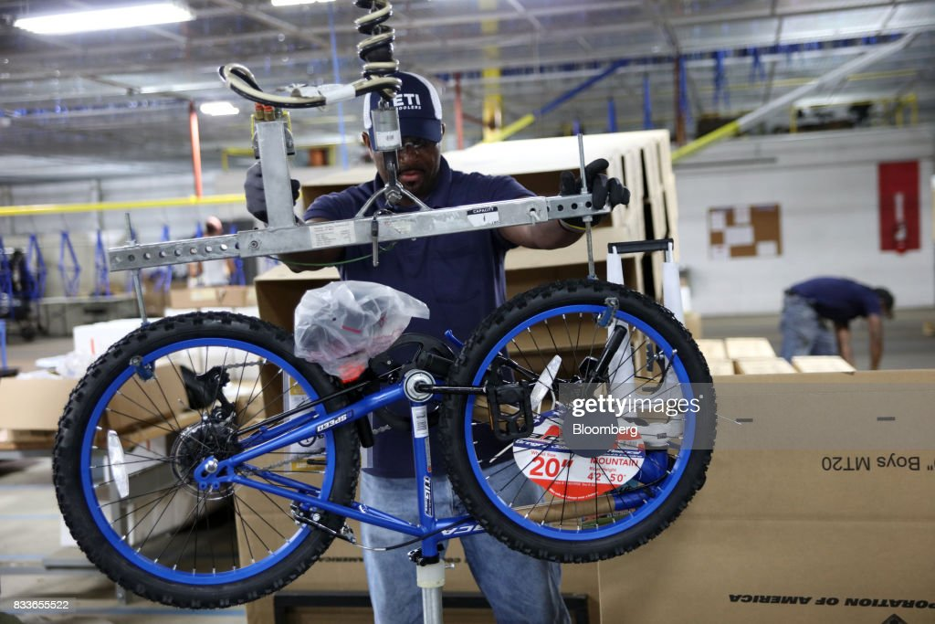 An employee prepares to package a Boys MT20 model bicycle at The Kent International Inc. Bicycle Corporation of America brand Assembly facility in Manning, South Carolina, U.S., on Sunday, June 25, 2017. Almost all of the roughly 18 million bicycles sold each year in the U.S. come from China and Taiwan. This year, about 130 workers at the Bicycle Corporation of America's new factory will assemble 350,000 bikes in the U.S. Photographer: Travis Dove/Bloomberg via Getty Images