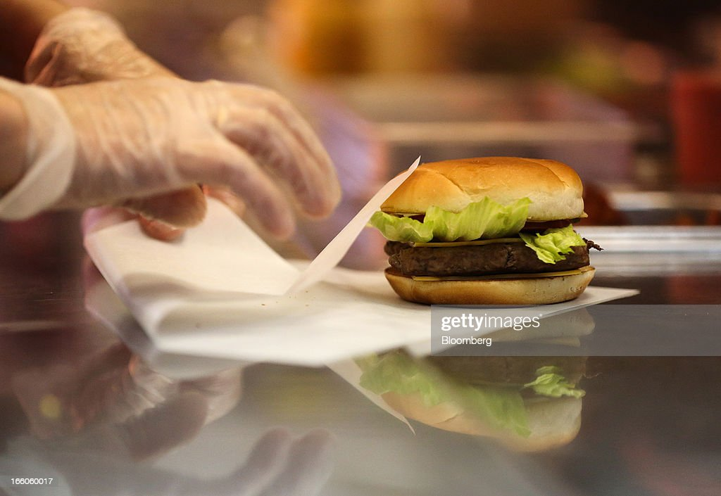 An employee prepares to wrap a freshly made hamburger in the kitchen area of a Wendy's fast food restaurant in Moscow, Russia, on Friday, April 5, 2013. McDonald's, which virtually created the market for burgers and fries in the country and convinced Russians it's OK to eat with their hands, must fend off a growing challenge from rivals Burger King Worldwide Inc., Subway Restaurants, Yum! Brands Inc. and Wendy's Co. Photographer: Andrey Rudakov/Bloomberg via Getty Images