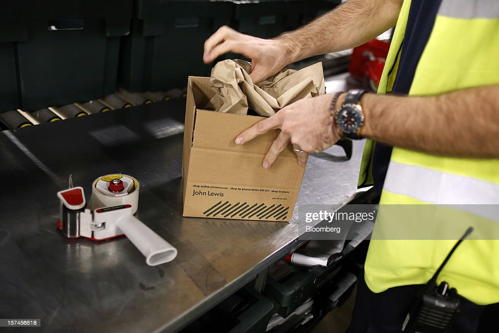 An employee processes a customer's order ahead of dispatch from the John Lewis Plc distribution centre in Milton Keynes, U.K., on Monday, Dec. 3, 2012. An index of U.K. retail sales rose to a five-month high in November, according to a monthly report from the Confederation of British Industry. Photographer: Simon Dawson/Bloomberg via Getty Images