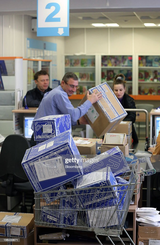 An employee processes a customer's parcel at a post office, operated by Russian Post, in Moscow, Russia, on Wednesday, Nov. 14, 2012. Alexander Kiselev, Russian Post's chief executive officer, needs to invest 200 billion rubles through 2020 to turn around a company that described its infrastructure as 'the most expansive, but the least efficient' in a strategy plan this year. Photographer: Andrey Rudakov/Bloomberg via Getty Images