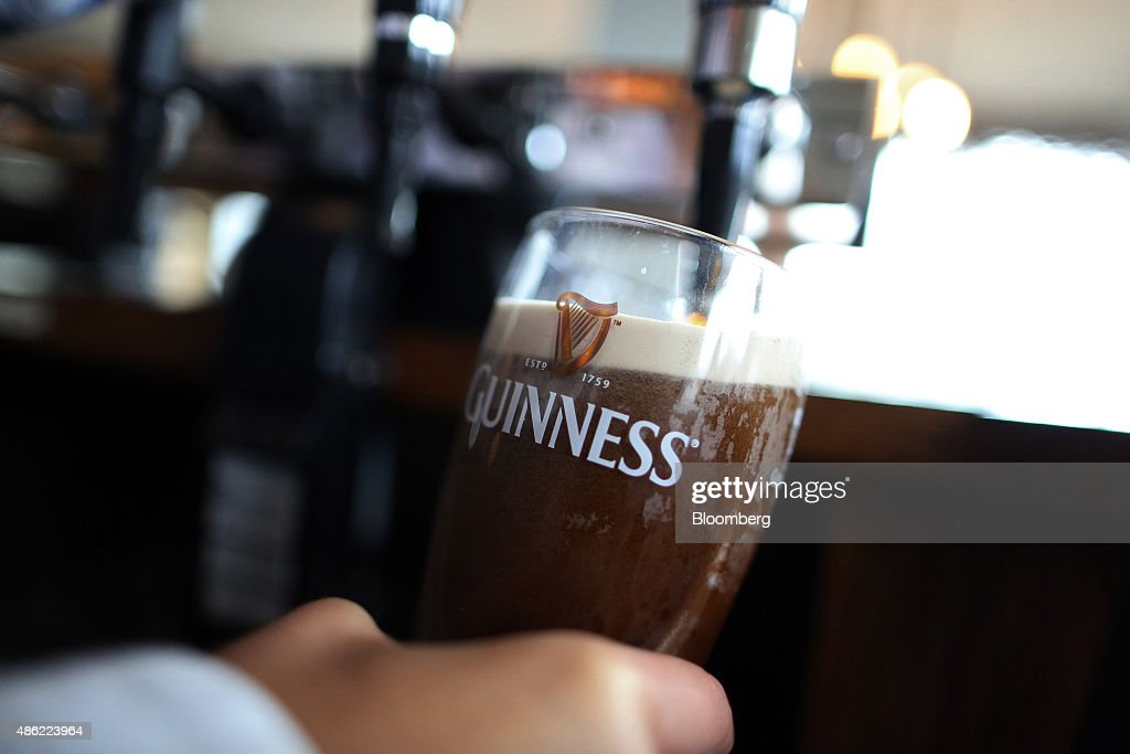 An employee pulls a pint of Guinness stout at The Honor Oak public house operated by Punch Taverns Plc in London UK on Wednesday Sept 2 2015 Punch...