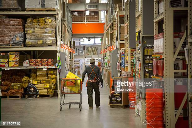 An employee pushes a cart inside a Home Depot Inc store in Jersey City New Jersey US on Saturday Feb 20 2016 Home Depot may exceed its 2015 forecast...