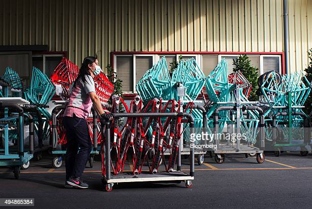 An employee pushes a cart of bicycle frames at the Giant Manufacturing Co bicycle manufacturing facility in Taichung Taiwan on Thursday Oct 22 2015...