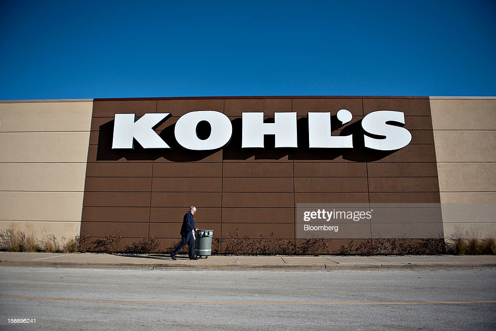 An employee pushes a garbage can outside a Kohl's Corp. store in Peoria, Illinois, U.S., on Wednesday, Jan. 2, 2013. The International Council of Shopping Centers is scheduled to release U.S. chain store sales data on Jan. 3. Photographer: Daniel Acker/Bloomberg via Getty Images