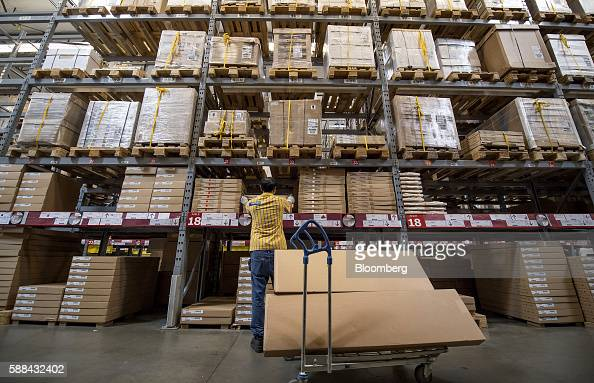 An employee puts a box on a shelf inside an IKEA AB store in Emeryville California US on Tuesday Aug 9 2016 The US Census Bureau is scheduled to...