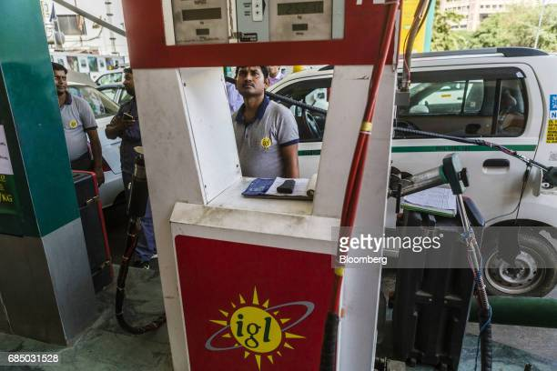 An employee refuels a vehicle with compressed natural gas at an Indraprastha Gas Ltd gas station in New Delhi India on Wednesday May 17 2017...