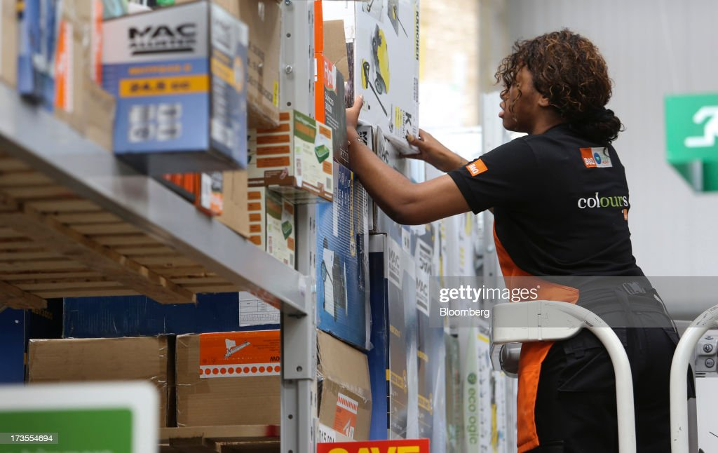An employee removes an item from a shelf inside a B&Q home improvement store, operated by Kingfisher Plc, in London, U.K., on Tuesday, July 16, 2013. Financial assistance for first-time home buyers in Britain is likely to prompt a resurgence of do-it-yourself spending after several years of decline, according to Kingfisher Plc Chief Executive Officer Ian Cheshire. Photographer: Chris Ratcliffe/Bloomberg via Getty Images