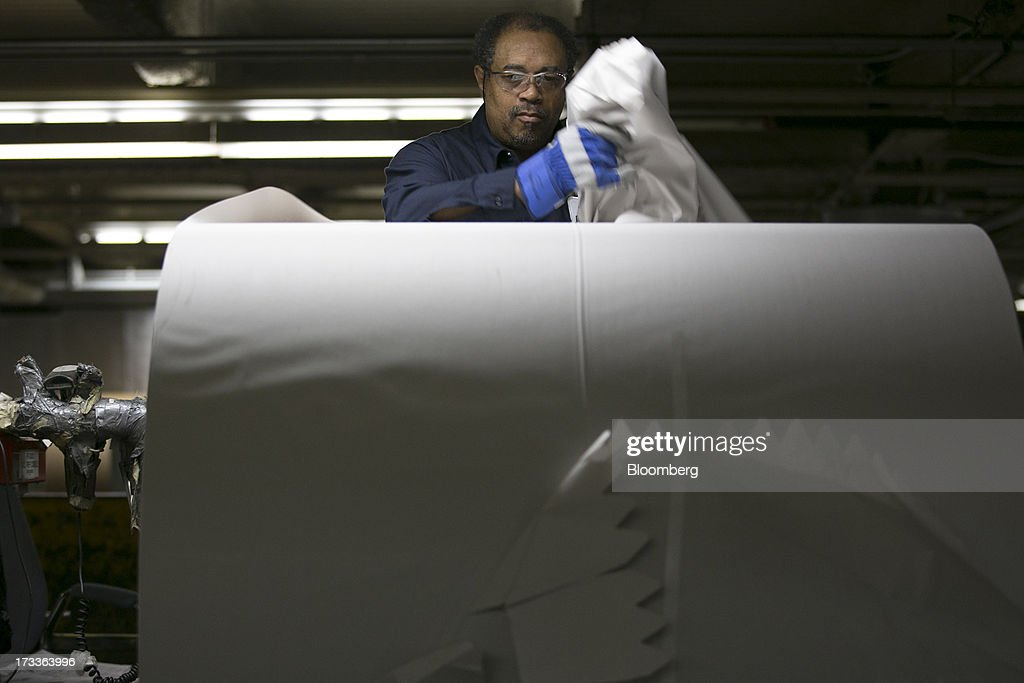 An employee removes the protective wrapping from a newsprint roll at the Washington Post newspaper production facility in Springfield, Virginia, U.S., on Friday, July 12, 2013. The Washington Post began publishing on Thursday, Dec. 6, 1877, and had a circulation of 10,000. The newspaper contained four pages and cost three cents a copy. Photographer: Andrew Harrer/Bloomberg via Getty Images