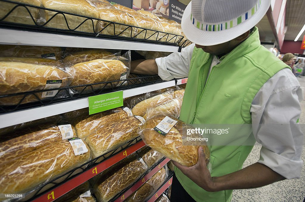 An employee restocks a display of freshly baked bread inside an Asda supermarket, the U.K. retail arm of Wal-Mart Stores Inc., in Watford, U.K., on Thursday, Oct. 17, 2013. U.K. retail sales rose more than economists forecast in September as an increase in furniture demand led a rebound from a slump the previous month. Photographer: Simon Dawson/Bloomberg via Getty Images