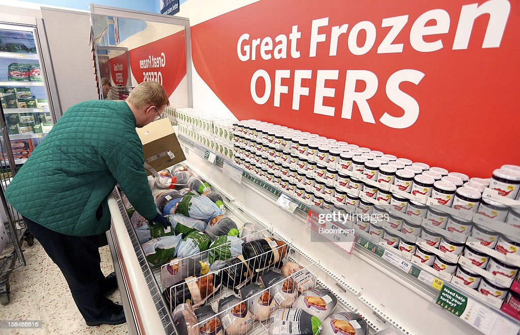 An employee restocks a freezer with frozen turkeys inside a Morrisons supermarket, operated by William Morrisons Supermarkets Plc, in Chadderton, U.K., on Monday, Dec. 17, 2012. The British Christmas is the biggest epicurean occasion of the year, with households spending a total of 4 billion pounds on food in the final week before Dec. 25. Photographer: Paul Thomas/Bloomberg via Getty Images