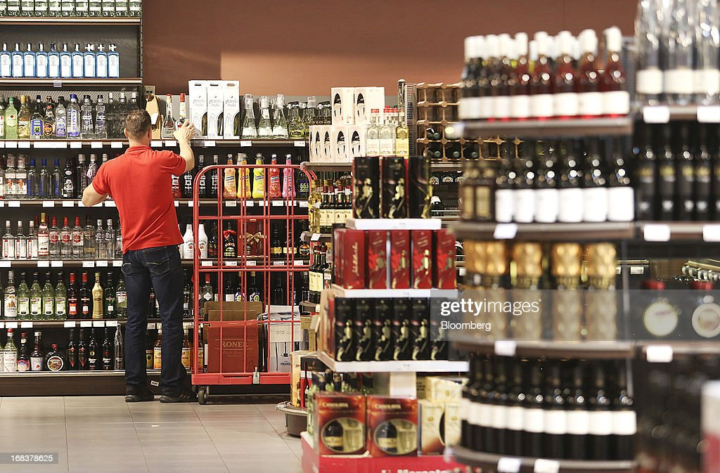 An employee restocks shelves in the alcohol department inside a Mercator Poslovni Sistem d.d. supermarket in Ljubljana, Slovenia, on Wednesday, May 8, 2013. In January Mercator reported its first full-year loss in fifteen years as the largest supermarket chain's sales in the Balkans last year suffered during the recession. Photographer: Chris Ratcliffe/Bloomberg via Getty Images