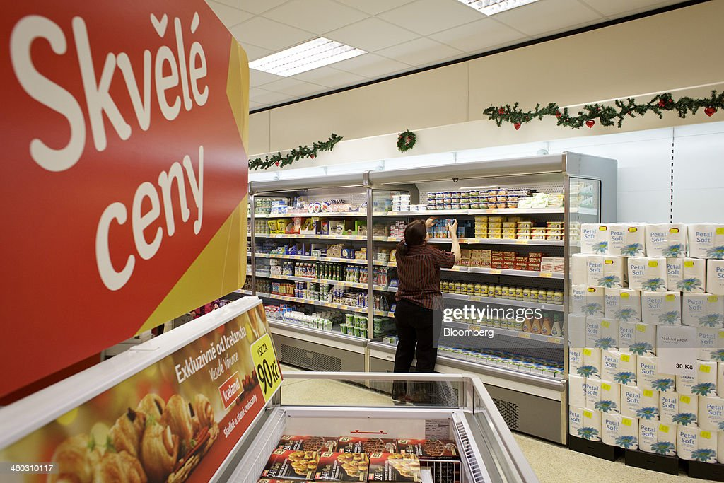 An employee restocks shelves in the dairy section of an Iceland Foods Ltd. store in Prague, Czech Republic, on Friday, Jan. 3. 2014. The Czech Republic's 2013 budget deficit of 80.9 billion koruna ($4.01 billion) beat the 100 billion-koruna target after the government cut spending, the Finance Ministry said. Photographer: Martin Divisek/Bloomberg via Getty Images