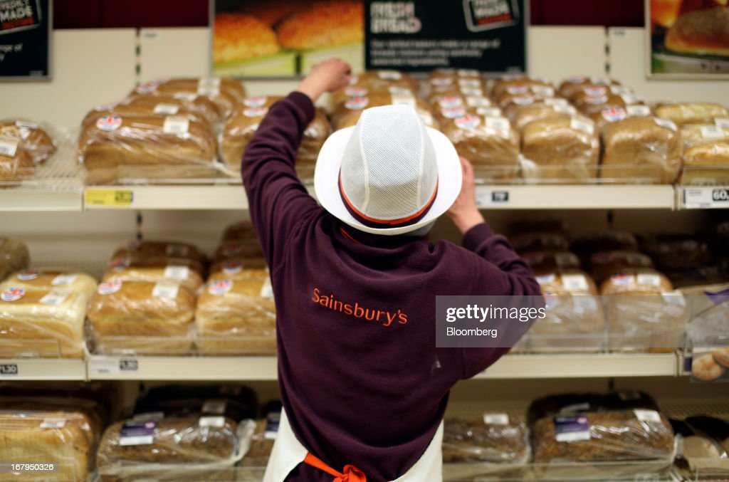 An employee re-stocks the fresh bread display at a Sainsbury's supermarket store, operated by J Sainsbury Plc, in Godalming, U.K., on Thursday, May 2, 2013. J Sainsbury Plc, the U.K.'s third-largest supermarket chain, will report full year results on May 8. Photographer: Chris Ratcliffe/Bloomberg via Getty Images