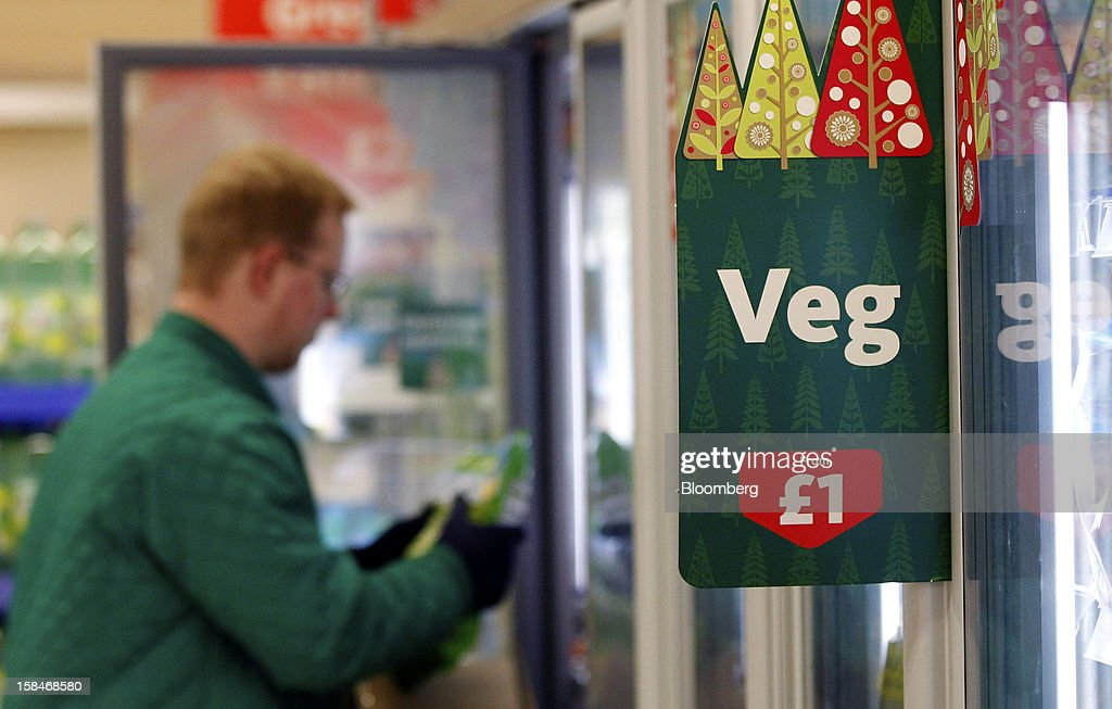 An employee restocks the frozen vegetable refrigerators inside a Morrisons supermarket, operated by William Morrisons Supermarkets Plc, in Chadderton, U.K., on Monday, Dec. 17, 2012. The British Christmas is the biggest epicurean occasion of the year, with households spending a total of 4 billion pounds on food in the final week before Dec. 25. Photographer: Paul Thomas/Bloomberg via Getty Images