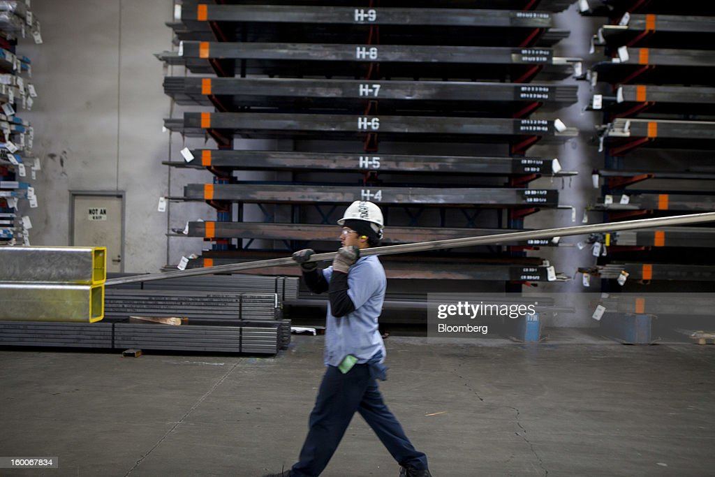 An employee retrieves steel at Industrial Metal Supply Co.'s warehouse in San Diego, California, U.S., on Thursday, Jan. 24, 2013. Industrial Metal Supply Co. is an aluminum, steel and sheet metal supplier serving businesses and retail custmers. Photographer: Sam Hodgson/Bloomberg via Getty Images