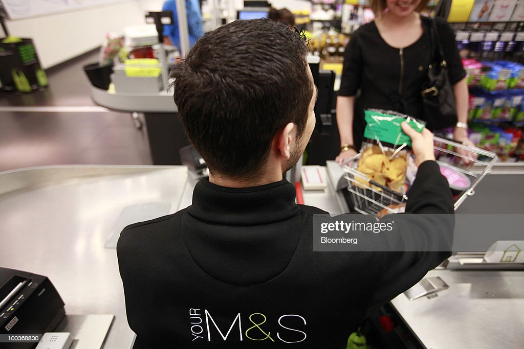 An employee rings up a customer's purchases at a Marks & Spencer Group Plc (M&S) store in The Westfield Centre shopping mall in London, U.K., on Monday, May 24, 2010. The company, the U.K.'s biggest clothing retailer, reports its full-year earnings tomorrow. Photographer: Jason Alden/Bloomberg via Getty Images