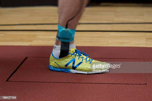 An employee runs down a track to demonstrate how shoes with pressure sensitive insoles are run over a force plate to get a reading that would be used...
